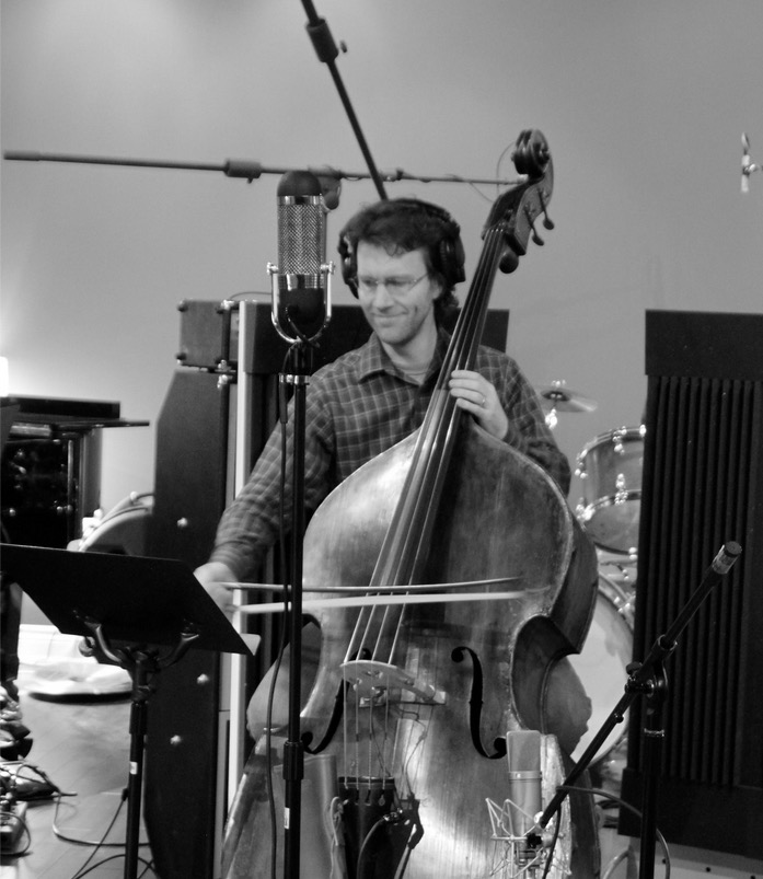 Michael playing double bass in studio